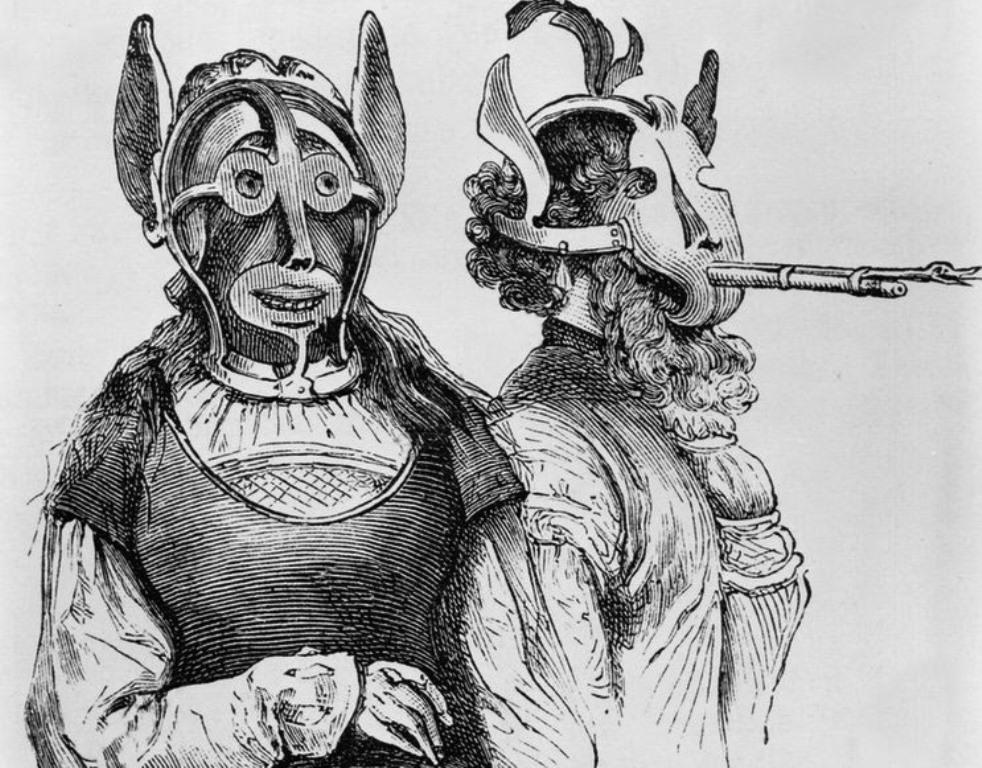 Two Gossip's Bridles, woodcut, c.1870 / Δύο χαλινάρια για κουτσομπόλες, ξυλογραφία περί του 1870 copyright, Wiki Creative Commons